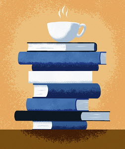 Cup of tea on top of pile of books