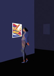 Woman looking at modern art in gallery exhibition