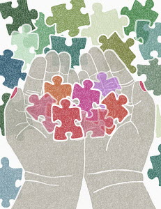 Cupped hands holding pink jigsaw puzzle piece figures