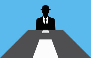 Faceless businessman sitting at conference table with road markings