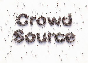 "Overhead view of people forming words """"crowd source"""""