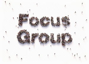 "Overhead view of people forming words """"focus group"""""