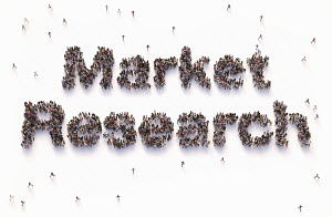 "Overhead view of people forming words """"market research"""""