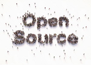 "Overhead view of people forming words """"open source"""""