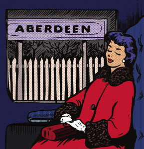 Woman asleep on train at Aberdeen station