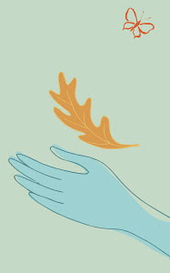 Hand catching autumn leaf