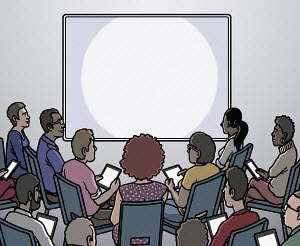 Group of people looking at blank projection screen