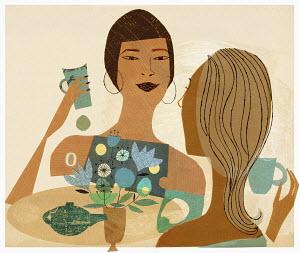 Girlfriends chatting drinking tea