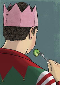 Man eating sprouts at Christmas