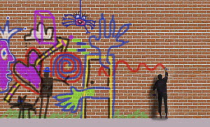 Man spraying graffiti on brick wall