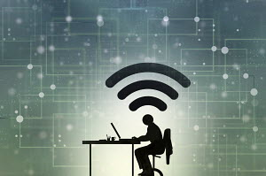Man working at desk connected to cyberspace