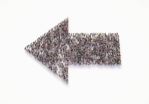 Overhead view of crowd of people forming arrow pointing left