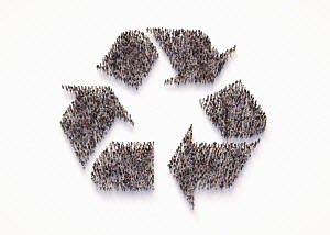 Overhead view of crowd of people forming recycling symbol