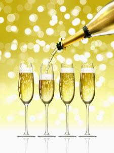 Gold champagne bottle filling sparkling champagne flutes