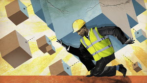 Construction industry manager struggling to carry heavy block breaking up into smaller cubes