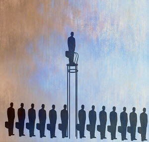 Businessman standing out above the crowd on tall chair