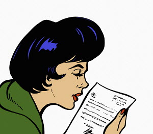 Close up of woman reading letter