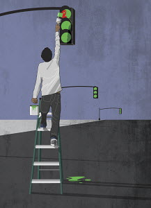 Man painting all traffic lights green