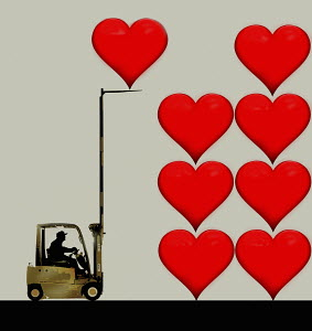 Forklift truck stacking up hearts