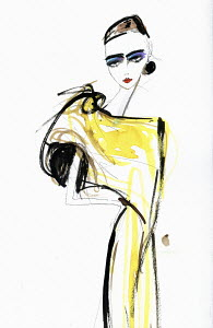 Fashion model in yellow evening gown