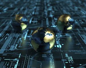 Globes on digital technology grid