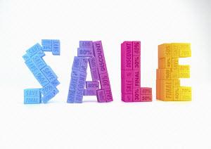 Blocks advertising discounts forming word 'Sale'