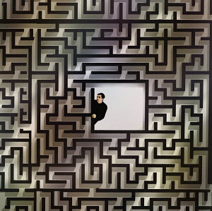 Nervous man peeping out from centre of maze