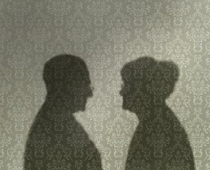 Shadows of elderly couple looking at each other
