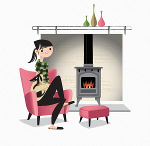 Woman cosy next to wood burning stove