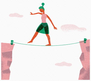 Woman balancing on tightrope between two cliffs