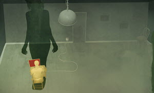 Shadow of woman looming over man using the internet