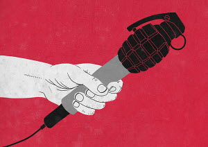 Hand holding grenade microphone