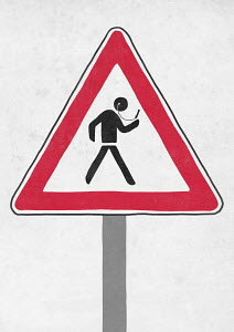 Road warning sign for figure distracted by smart phone