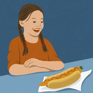Girl delighted at carrot in hot dog bun