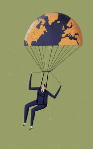Businessman controlling globe parachute