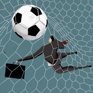 Businessman goalkeeper letting goal in
