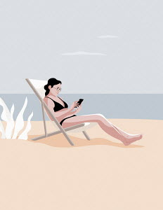 Woman relaxing on beach using smart phone