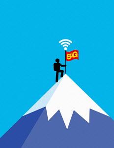 Mountaineer placing 5G flag on mountain summit