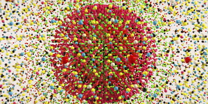 Lots of multi coloured balls exploding from circle pattern
