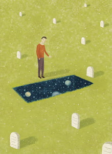 Man looking into outer space in grave