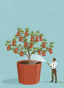 Happy businessman watering British pound money tree