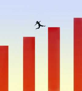 Woman jumping across bar chart