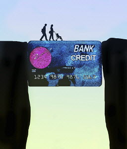 Family using credit card to bridge the gap
