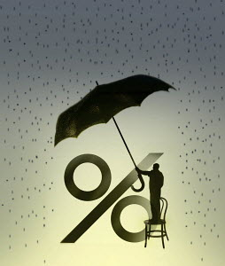 Man holding umbrella over percentage sign