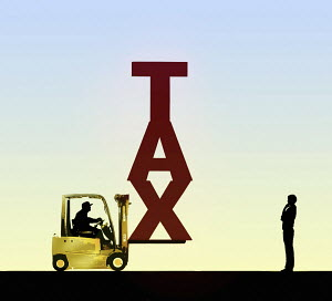 Man contemplating the word Tax on forklift truck