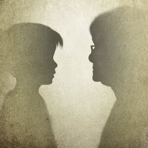 Silhouette profiles of young girl and elderly woman