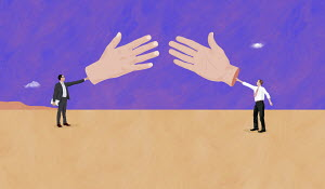 Two businessman reaching to shake large hands