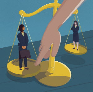 Hand tipping the scale between two job candidates