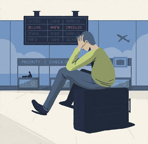 Man at airport in despair at cancelled flight