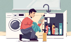 Man reading label of laundry product